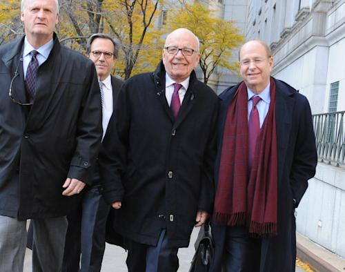 "Rupert Murdoch, center, exits State Supreme court, Wednesday, Nov. 20, 2013, in New York. Murdoch and his soon-to-be-ex-wife said they were parting with ""mutual respect"" Wednesday after telling a judge they had reached a divorce deal. (AP Photo/ Louis Lanzano)"