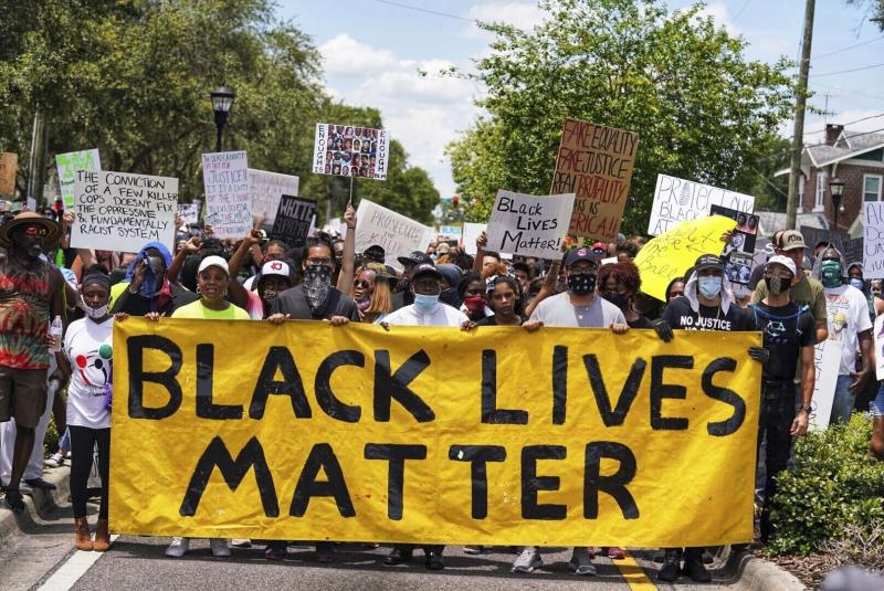 Demonstrators march in Tampa Sunday, May 31, 2020 for a second day in a row as protestors take to the streets of Tampa to protest the Memorial Day death of George Floyd in Minneapolis.  (Martha Asencio-Rhine/Tampa Bay Times via AP)