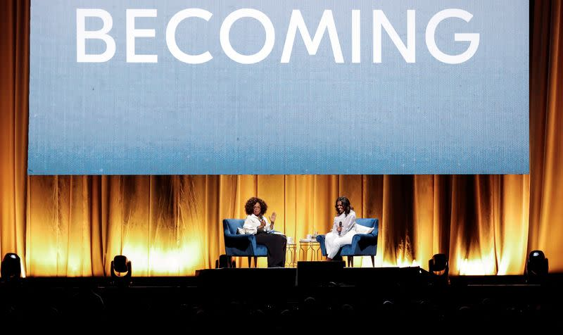 FILE PHOTO: Oprah Winfrey talks with former first lady Michelle Obama in Chicago