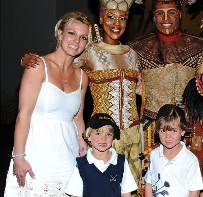 Britney Spears and her sons Jayden James and Sean Preston pose with Kissy Simmons, Derrick Willimas, Ntsepa Pitjeng and Niles Rivers of The Lion King at Mandalay Bay in Las Vegas on April 3, 2011  -- Getty Images