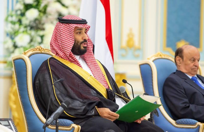Saudi Crown Prince Mohammed bin Salman speaks as Yemen's President Abd-Rabbu Mansour Hadi is seen in the background, in Riyadh