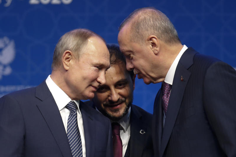 FILE - In this Jan. 8, 2020 file photo, Turkey's President Recep Tayyip Erdogan, right and Russia's President Vladimir Putin, left, talk during a ceremony in Istanbul for the inauguration of the TurkStream pipeline. A summit meeting between the Turkish and Russian leaders scheduled for Thursday, March 5, 2020, may be the last chance to work out a deal that avoids a calamity in Syria's northwest. Faced with mounting losses for his troops in Syria and a potential wave of refugees fleeing fighting in northwestern Syria, Turkish President Recep Tayyip Erdogan is eager for a cease-fire and Vladimir Putin is ready to bargain. (AP Photo/Lefteris Pitarakis, File)