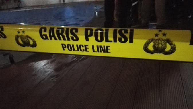 Ilustrasi garis polisi. (Liputan6.com/Raden Trimutia Hatta)