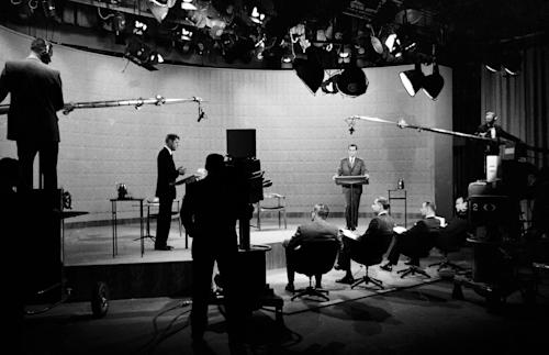 FILE - In this Oct. 21, 1960 file photo, Democratic presidential candidate, Sen. John F. Kennedy, center left, and Republican candidate, Vice President Richard Nixon, stand in a television studio during their presidential debate in New York. Polls found those who listened on radio awarded Nixon the debate victory. Those watching on TV gave Kennedy the nod. (AP Photo)