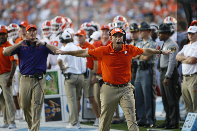 Clemson Tigers head coach Dabo Swinney argues for an incomplete pass call against the North Carolina Tar Heels in the second half at Kenan Memorial Stadium. The Clemson Tigers won 21-20. (USAT)