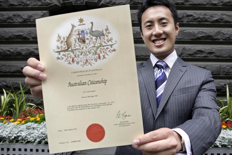 Julian Soon holds his Australian Citizen Certificate
