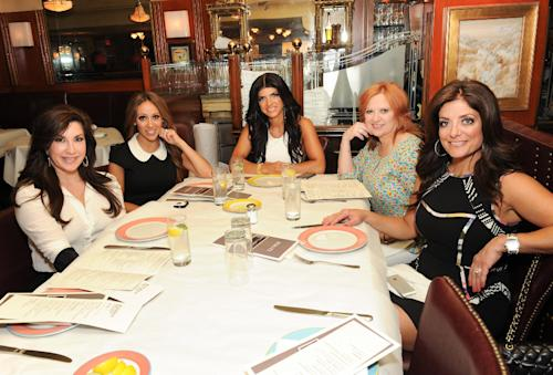 """This May 30, 2013 photo shows cast members from Bravo''s """"The Real Housewives of New Jersey"""", from left, Jacqueline Laurita, Melissa Gorga, Teresa Giudice, Caroline Manzo and Kathy Wakile at Bond 45 in New York. The popular reality show airs Sundays at 8 p.m. EST on Bravo. (Photo by Evan Agostini/Invision/AP)"""