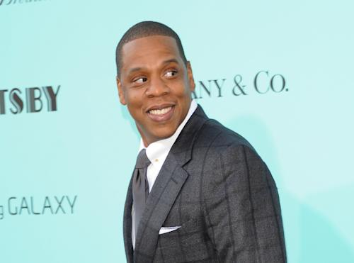 "FILE - This May 1, 2013 file photo shows Jay-Z at ""The Great Gatsby"" world premiere at Avery Fisher Hall in New York. Jay-Z is teaming up with Samsung to release his new album, unveiling a three-minute commercial during the NBA Finals and announcing a deal that will give the music to 1 million users of Galaxy mobile phones. The new album, called ""Magna Carta Holy Grail,"" will be free for the first 1 million android phone owners who download an app for the album. Those who do so will get the album on July 4, three days before its official release. (Photo by Evan Agostini/Invision/AP, file )"