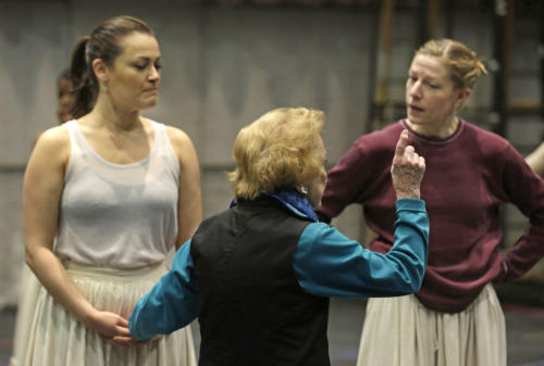 "In this April 26, 2013 photo, choreographer Gemze de Lappe, center, talks with leading lady, Ashley Brown, who portrays Laurey, left, and ensemble member Ariane Dolan during a rehearsal of Rodgers and Hammerstein's ""Oklahoma!"" at the Lyric Opera of Chicago. De Lappe first danced in ""Oklahoma!"" in 1943 as a member of the Broadway hit's first national touring company and now 70 years later at age 91 she's choreographing a production of the musical at the Lyric. (AP Photo/M. Spencer Green)"