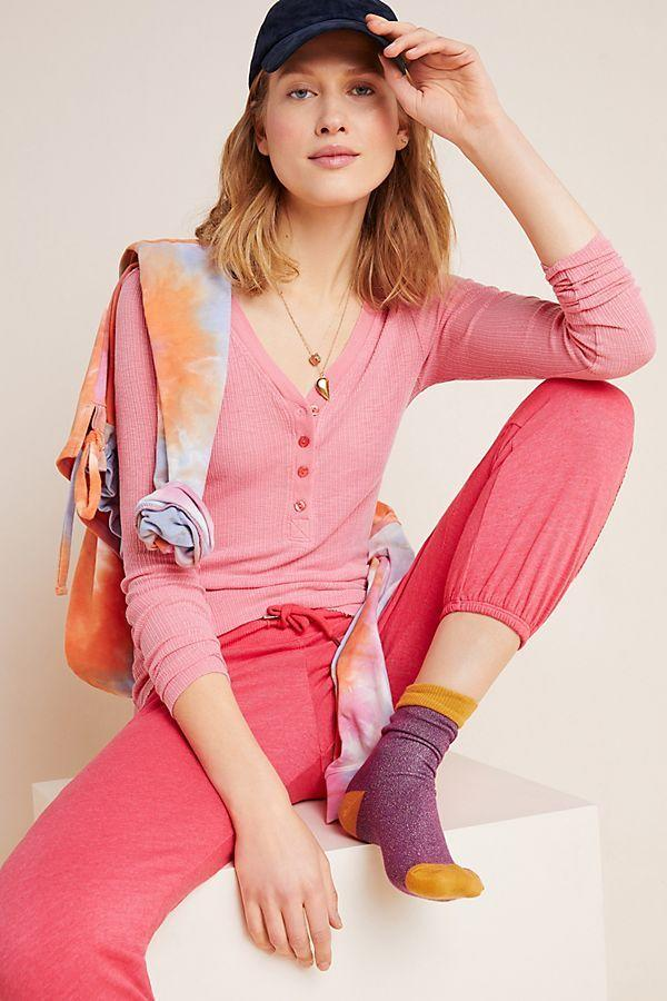 """<p><strong>Sundry</strong></p><p>anthropologie.com</p><p><strong>$51.60</strong></p><p><a href=""""https://go.redirectingat.com?id=74968X1596630&url=https%3A%2F%2Fwww.anthropologie.com%2Fshop%2Fsundry-ribbed-henley-top&sref=https%3A%2F%2Fwww.cosmopolitan.com%2Fstyle-beauty%2Fg31900128%2Fanthropologie-sale-work-from-home%2F"""" target=""""_blank"""">Shop Now</a></p><p>I know you love that T-shirt you got for free when you were in college, but this soft button-up cutie will look much better when you're Zoom-ing your co-workers.</p>"""