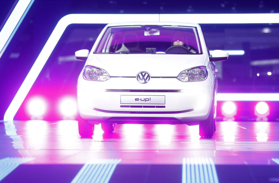 The Volkswagen e-up! rolls onto the stage during the first press day of the 65th Frankfurt Auto Show in Frankfurt, Germany, Tuesday, Sept. 10, 2013. More than 1,000 exhibitors will show their products to the public from Sept. 12 through Sept.22, 2013. (AP Photo/Michael Probst)