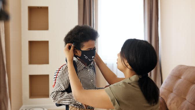 Ilustrasi Penggunaan Masker Kain Credit: pexels.com/August