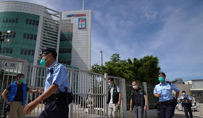 Hong Kong police raid the offices of the tabloid-style Apple Daily newspaper at the Next Digital Limited building in Tseung Kwan O on Monday. Photo: Winson Wong