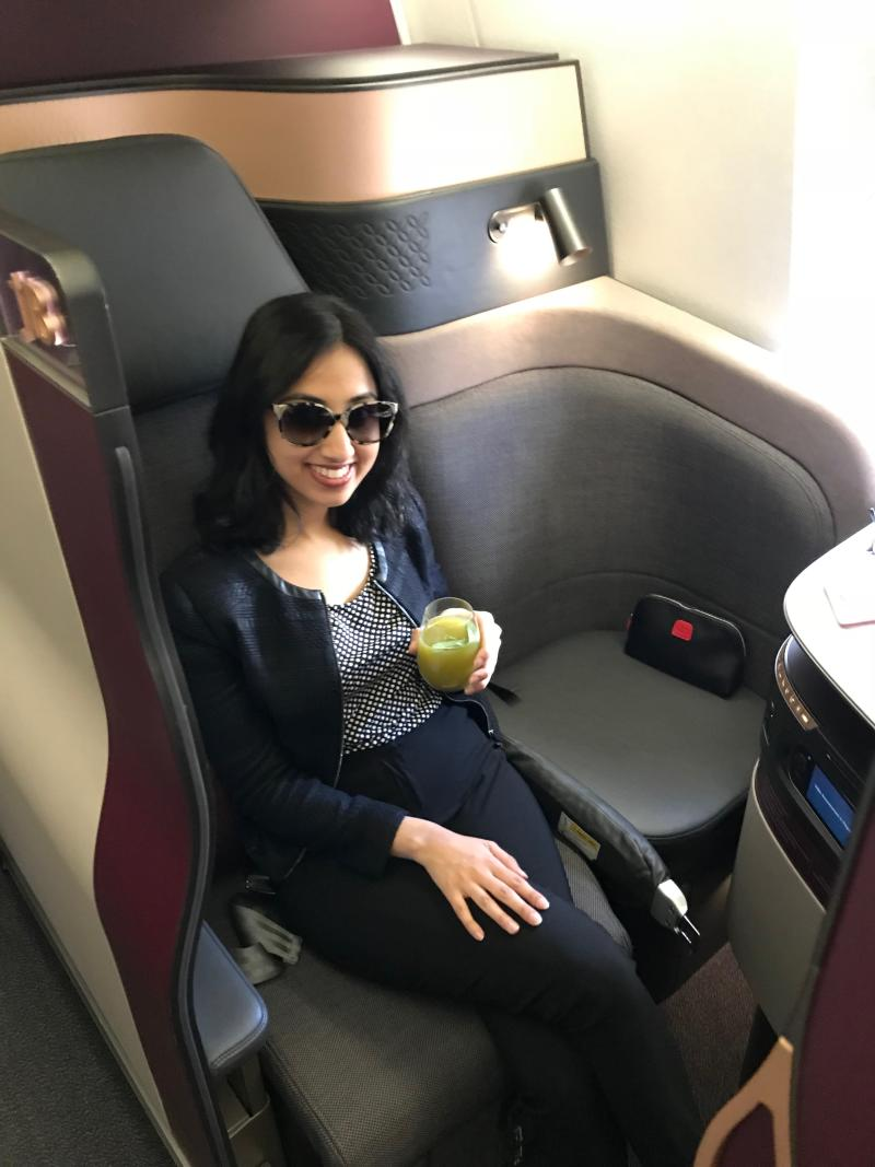 This is me after I did a little happy dance after boarding the Q-suite business class experience from Sydney to Doha. Photo: Yahoo Lifestyle