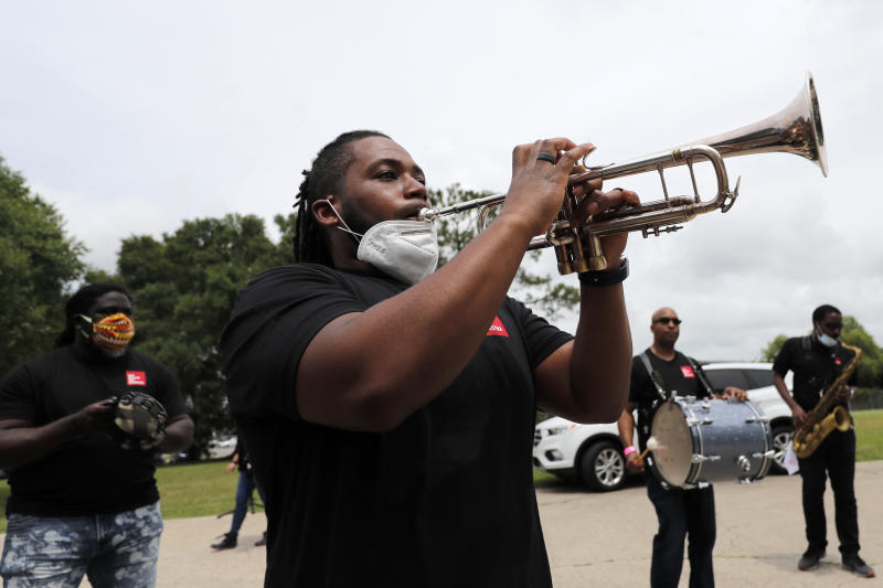Members of the New Orleans Jazz Orchestra serenade healthcare workers at New Orleans East Hospital, as a tribute for their care of COVID-19 patients, outside the hospital in New Orleans, Friday, May 15, 2020.  A New York woman collaborated with the New Orleans Jazz Orchestra to put on what she calls a stimulus serenade to give moral support to front-line hospital workers and COVID-19 patients in New Orleans.   (AP Photo/Gerald Herbert)
