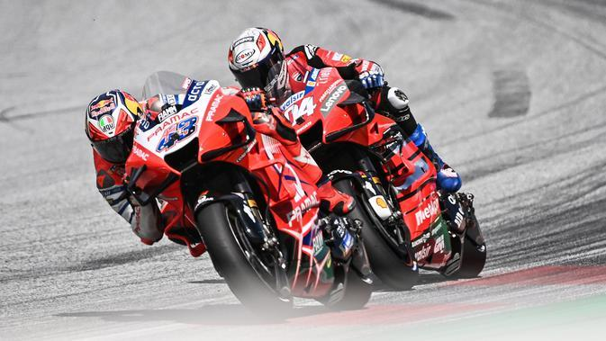 Jack Miller versus Andrea Dovizioso pada balapan MotoGP Austria, 16 Agustus lalu. (Joe Klamar / AFP)