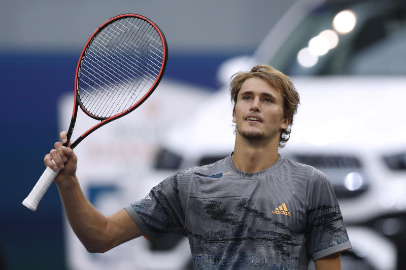 Alexander Zverev of Germany gestures to spectators after defeating Jeremy Chardy of France in the men's singles match at the Shanghai Masters tennis tournament at Qizhong Forest Sports City Tennis Center in Shanghai, China, Wednesday, Oct. 9, 2019. (AP Photo/Andy Wong)