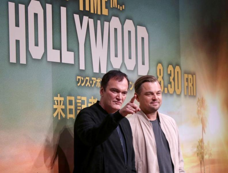 Actor Leonardo DiCaprio and director Quentin Tarantino pose for a photo during a news conference for the film 'Once Upon a Time In Hollywood' in Tokyo