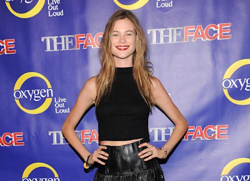"""FILE - This Feb. 5, 2013 file photo shows model Behati Prinsloo at the Oxygen Network's """"The Face"""" premiere party in New York. Adam Levine's representative confirmed Tuesday that the Maroon 5 singer is engaged to model Behati Prinsloo. The couple started dating last year. The 34-year-old singer proposed to 24-year-old Prinsloo in Los Angeles this weekend. (Photo by Evan Agostini/Invision/AP, File)"""