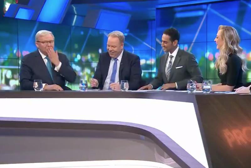 Former Australian prime minister Kevin Rudd puts his hand to his mouth after swearing on the Project as co-hosts laugh.