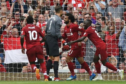 Up and running: Mohamed Salah celebrates his first goal of the season