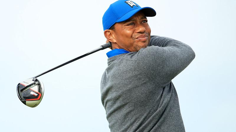 Tiger Woods, pictured teeing off at the British Open, was seen grimacing on a number of shots.