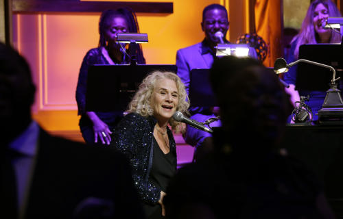 Singer-songwriter Carole King, center, performs during an event to honor her with the Gershwin Prize for Popular Song, at the Library of Congress, Tuesday, May 21, 2013 in Washington. (AP Photo/Alex Brandon)