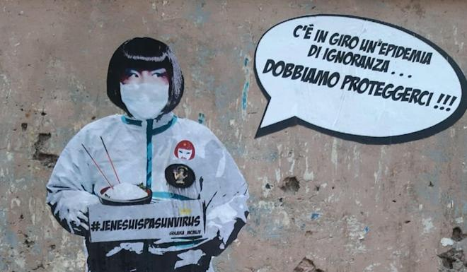 A detail of a mural about the coronavirus outbreak in the Chinese district of Rome on Tuesday. The image of an Asian woman says 'There is an epidemic of ignorance around … We must protect ourselves' and the figure holds a sign reading '#JeNeSuisPasUnVirus'. Photo: EPA-EFE