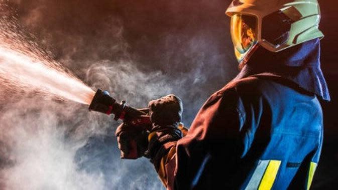 ilustrasi petugas pemadam kebakaran. (iStockphoto)