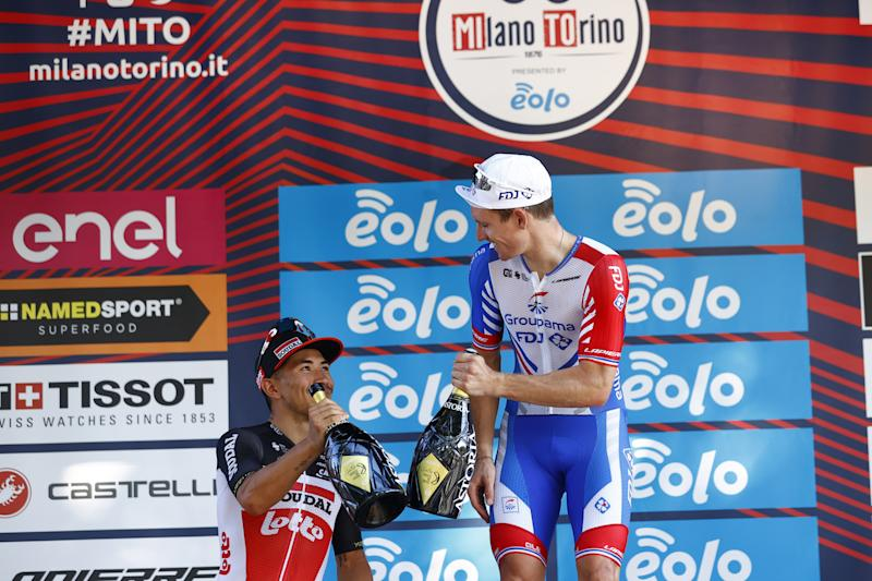 Caleb Ewan and winner Arnaud Demare on podium Milano-Torino 2020