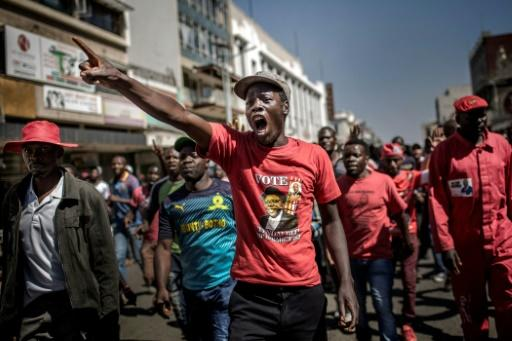 Supporters of the opposition Movement for Democratic Change (MDC) party protest in Harare against alleged fraud by the election authority and ruling party after the announcement of results on August 1, 2018
