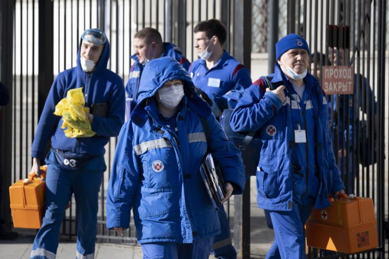 In this photo taken on Friday, Feb. 21, 2020, Medical workers walk after checking passengers where a passenger was identified with suspected coronavirus after arriving from Kyiv at Kievsky (Kyiv's) rail station in Moscow, Russia. Russia suspended all trains to China and North Korea, shut down its land border with China and Mongolia and extended a school vacation for Chinese students until March 1. Russian authorities are going to great lengths to prevent the new coronavirus from spreading in the capital and elsewhere. (AP Photo/Alexander Zemlianichenko)