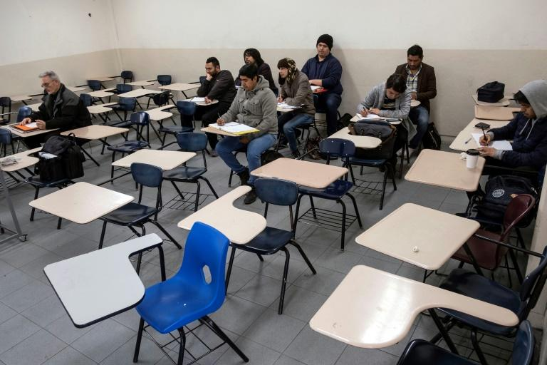 Male students attend a class at the Universidad Autonoma de Baja California in Tijuana, Mexico as women stayed away in the nationwide 'A Day Without Us' protest against gender violence