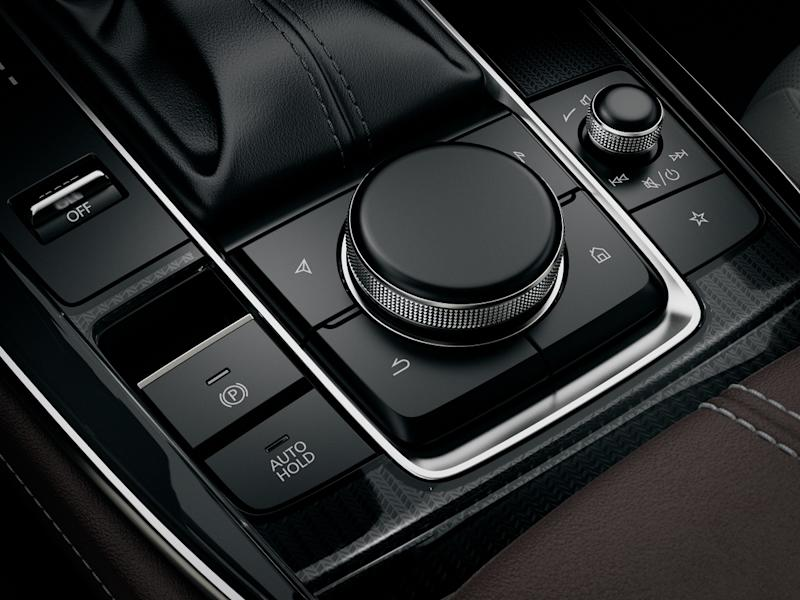 The Mazda Sport Mode button is located next to the gear stick for a sporty driving experience. — Picture courtesy of Bermaz Motor