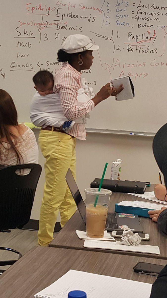 Ramata Cissé was photographed holding her student's baby during a three-hour class after her student couldn't find a babysitter. Source: Anna Cissé/Twitter