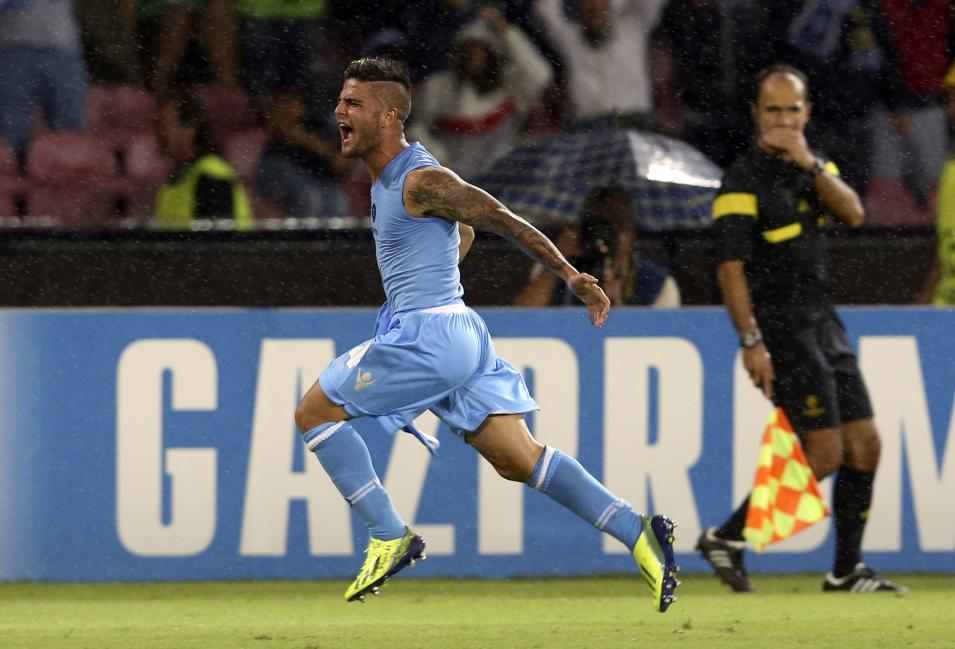 Napoli's Insigne celebrates after scoring against Borussia Dortmund during their Champions League Group F soccer match in Naples
