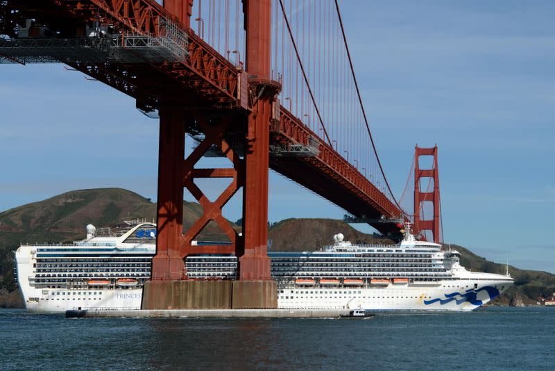 The Grand Princess cruise ship carrying passengers who have tested positive for coronavirus passes the Golden Gate bridge in San Francisco