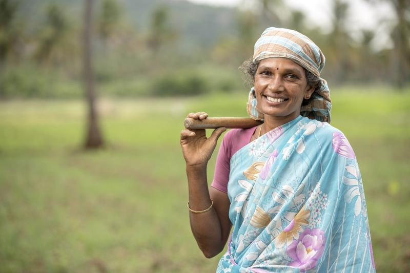 Indian farmer women on farm field with happy face, Tamil nadu, India.