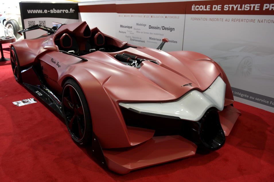 The new concept car Sbarro Fleche Rouge is shown during the press day at the 84th Geneva International Motor Show in Geneva, Switzerland, Wednesday, March 5, 2014. (AP Photo/Keystone, Martial Trezzini)