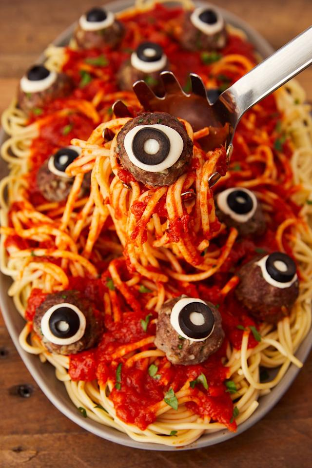 "<p>On Halloween, meatballs = monster eyeballs. </p><p>Get the recipe from <a href=""https://www.delish.com/cooking/recipe-ideas/a23712888/eyeball-pasta-halloween-dinner-recipe/"" target=""_blank"">Delish</a>. </p>"