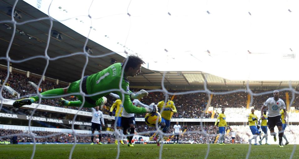 Newcastle United goalkeeper Krul makes a save from Tottenham Hotspur's Sigurdsson during their English Premier League soccer match in London