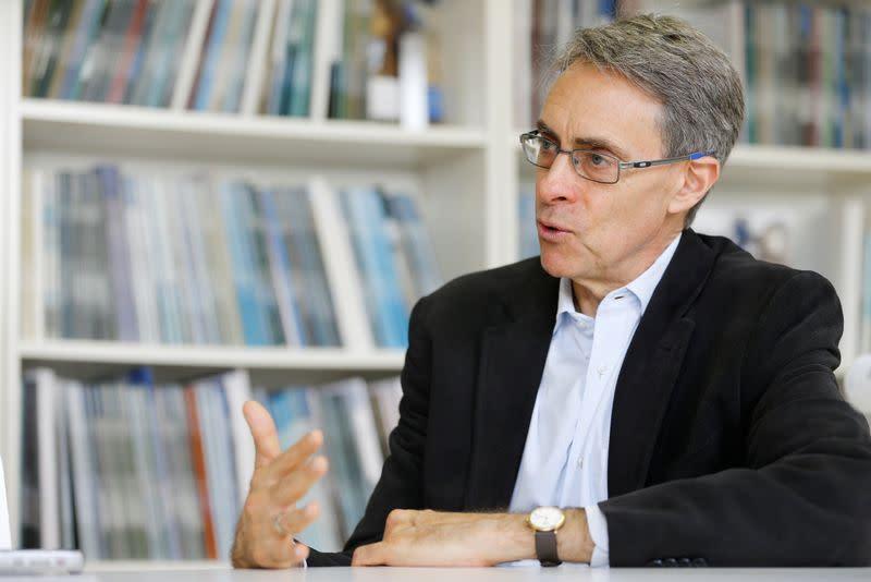 Human Rights Watch Executive Director Kenneth Roth speaks during a interview with Reuters in Geneva