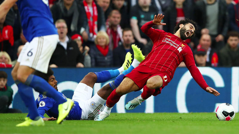 Hamza Choudhury of Leicester City collides with Mohamed Salah of Liverpool during the Premier League match between Liverpool FC and Leicester City at Anfield on October 05, 2019 in Liverpool, United Kingdom. (Photo by Clive Brunskill/Getty Images)