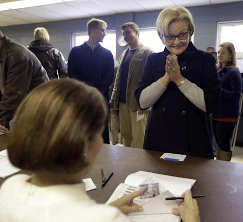 U.S. Sen Claire McCaskill, D-Mo., applauds as she checks in with election officials before voting at Kirkwood Community Center Tuesday, Nov. 6, 2012, in Kirkwood, Mo. McCaskill is running for reelection against Republican challenger Rep. Todd Akin, R-Mo. (AP Photo/Jeff Roberson)