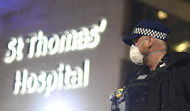 A police officer outside St Thomas' Hospital where British Prime Minister Boris Johnson was being treated. Photo: AP