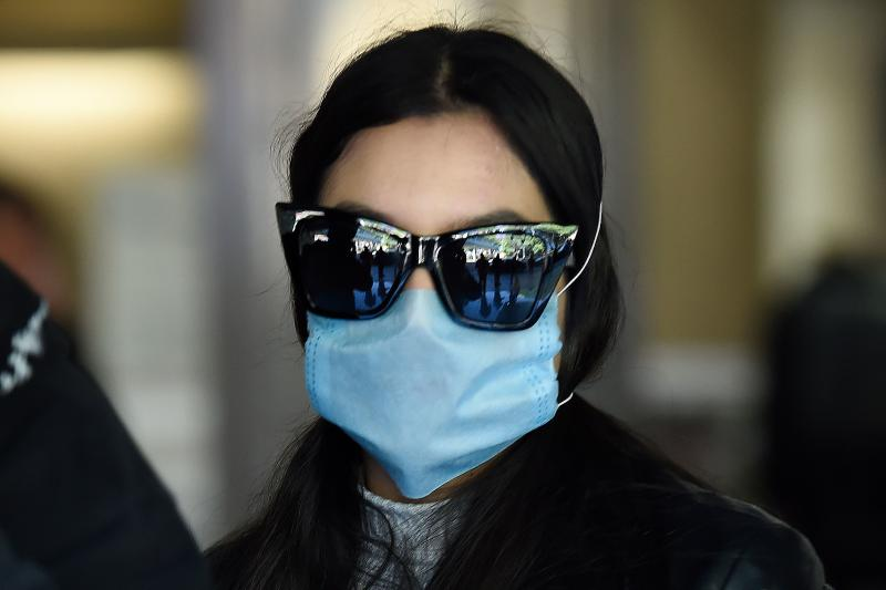 A passenger wears a protective mask at Mexico City's international airport, on February 28, 2020. - Mexico's Health Ministry confirmed the country's first case of coronavirus on Friday, saying a young man had tested positive for it in the capital. (Photo by Alfredo ESTRELLA / AFP) (Photo by ALFREDO ESTRELLA/AFP via Getty Images)