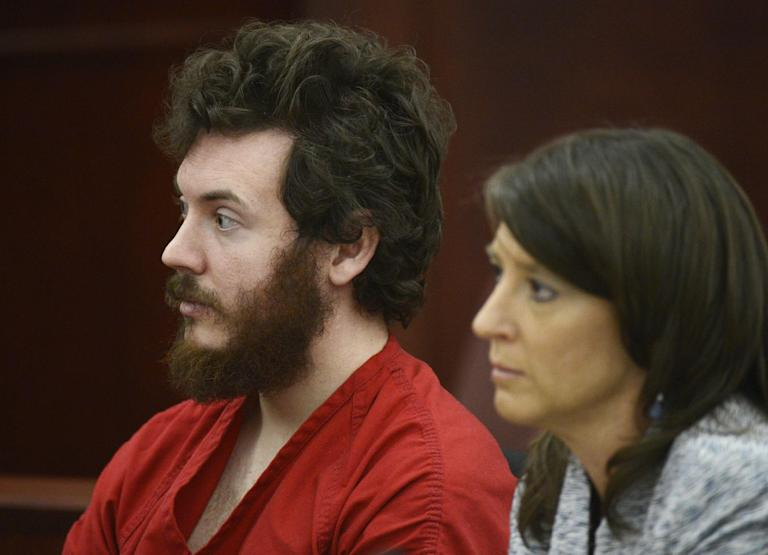 James Holmes sits with defense attorney Tamara Brady during his arraignment in district court in Centennial, Colo., on Tuesday, March 12, 2013. Judge William Blair Sylvester entered a not guilty plea on behalf of James Holmes on Tuesday after the former graduate student's defense team said he was not ready to enter one. (AP Photo/Denver Post, RJ Sangosti, Pool)
