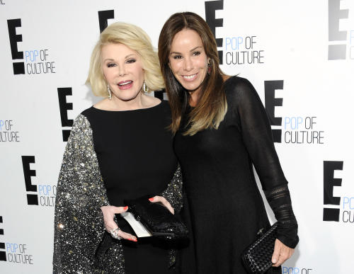 "FILE - This April 30, 2012 file photo shows comedian and TV host Joan Rivers from the show ""Fashion Police"" and her daughter Melissa Rivers at an E! Network upfront event in New York. Joan Rivers turned 80, a milestone that has prompted the E! network to celebrate. Its regular one-hour edition of ""Fashion Police"" will be a black-tie birthday salute, preceded nightly through Thursday by special half-hours featuring guest appearances by celebrities and even victims of past fashion slams. (AP Photo/Evan Agostini, file)"