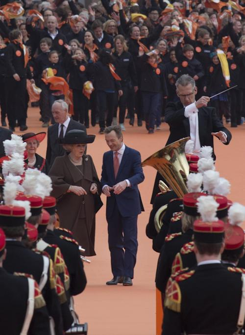 "Dutch Queen Beatrix, center left, and museum director Wim Pijbes, center right, prepare to officially open the renovated Rijksmuseum in Amsterdam, Netherlands, Saturday April 13, 2013. The Rijksmuseum, home of Rembrandt's ""The Night Watch"" and other national treasures reopens its doors to the public after a decade-long renovation. The first day, Saturday April 13, admissions are free and the museum stays open until midnight. (AP Photo/Peter Dejong)"