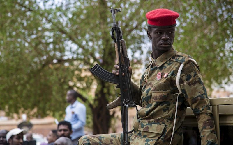 Soldiers are stationed at the trial of ousted former Sudanese President Omar al-Bashir - Mahmoud Hjaj/Anadolu Agency via Getty Images